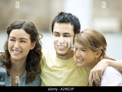 Teenage friends having photo taken with cell phone - Stock Photo