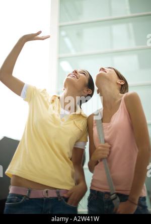 Teen girls looking up - Stock Photo