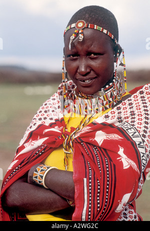 Kenya East Africa Young Masai woman in traditional dress - Stock Photo