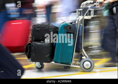 male passenger pushes luggage on trolley out of Reina Sofia Sur TFS South Airport Tenerife Canary Islands Spain - Stock Photo