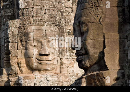 Enigmatic faces of the Bayon Temple Angkor Thom Cambodia 2 - Stock Photo