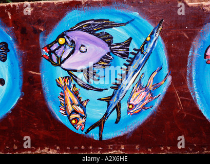 Australian art. Painting of still life with fishes on a plate. - Stock Photo