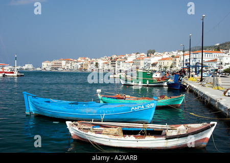 Colorful fishing boats and pleasure craft in the harbor at Samos or Vathi village on the island of Samos Greece - Stock Photo