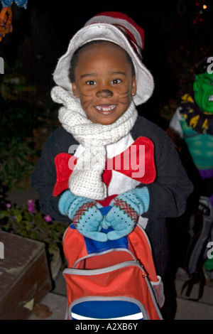 African American in Halloween trick or treater in Cat in the Hat costume. St Paul Minnesota USA - Stock Photo