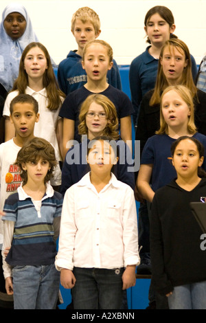 Racially mixed children's chorus age 9. Hurricane Katrina benefit concert - Horace Mann School. St Paul Minnesota - Stock Photo