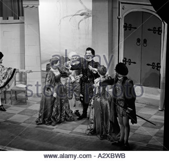 Entertainment .Theatrical production. Actors on stage in period costume opera drama. - Stock Photo