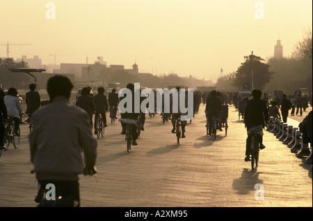 cyclists in shanghai, china - Stock Photo