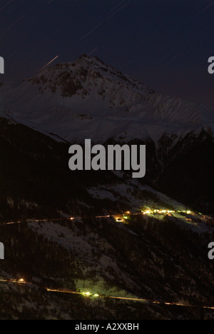 Stars falling down. Mountains by night covered with snow. Val d'Hérens. Valais. Switzerland. - Stock Photo