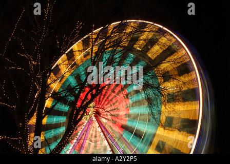 Ferris wheel at Edinburgh's Christmas festivities, East Princes Street Gardens, Edinburgh, Scotland, UK. - Stock Photo