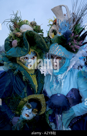 Carnevale Revelers with a Sea-themed Costume in Blues and Greens and Golds, Venice, Italy - Stock Photo