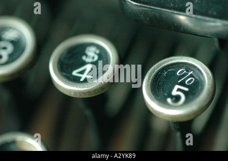 An Old manual typewriter with its working keyes with numbers and letters Money percentage 4 5 - Stock Photo