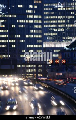 DEU Germany Essen Motorway A40 Office buildings of RAG Ruhrkohle AG Traffic jam - Stock Photo