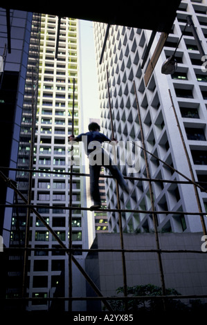 In asia bamboo is often used as scaffolding as in this hong kong building site - Stock Photo