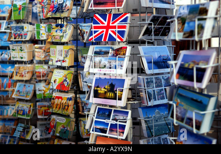 Postcards on sale along Brighton seafront in the UK - Stock Photo