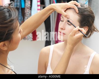 Makeup artist working on model - Stock Photo