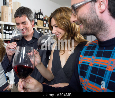 Group of friends at wine tasting - Stock Photo
