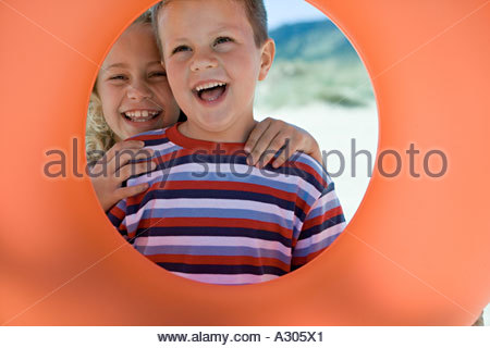 Girl and boy with rubber ring - Stock Photo