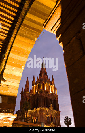 MEXICO San Miguel de Allende Spire of Parroquia lit at night landmark church in center of town plaza - Stock Photo