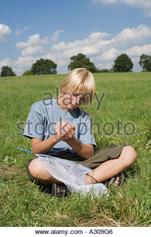 Boy holding a butterfly - Stock Photo