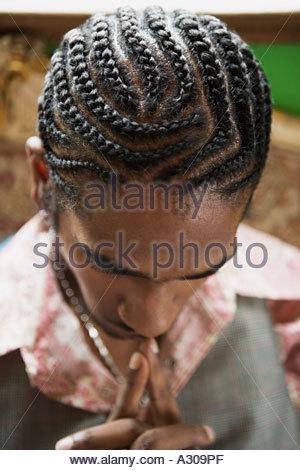 Young man with braided hair - Stock Photo