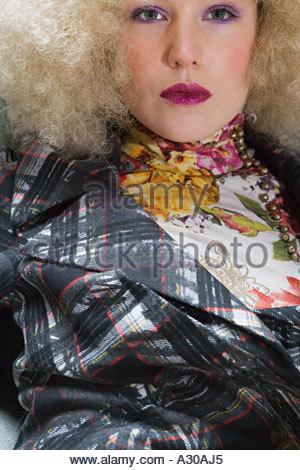 Woman wearing blond wig - Stock Photo