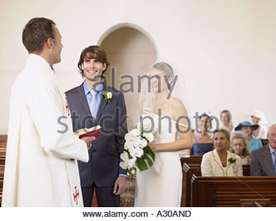 Bride and groom being married - Stock Photo