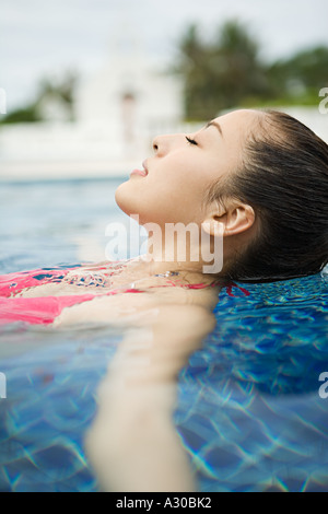 Beautiful woman relaxing in swimming pool - Stock Photo