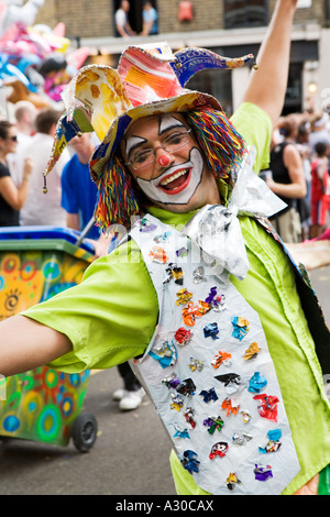 Performing carnival clown in Islington - Stock Photo