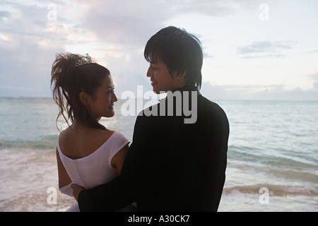 Newlyweds on beach - Stock Photo
