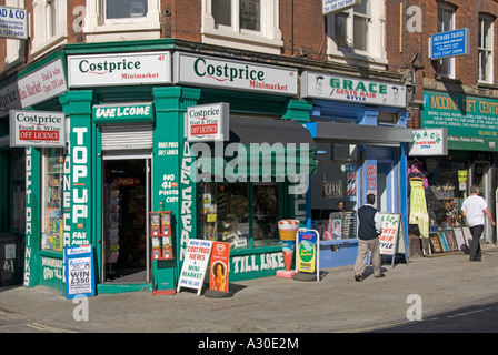 Costprice corner shop and gents hair style shop in Brick Lane Shoreditch East London E1 - Stock Photo