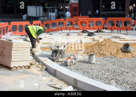 Kerb & slab laying of pavements at road junction - Stock Photo