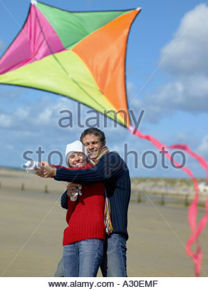 Couple flying a kite - Stock Photo