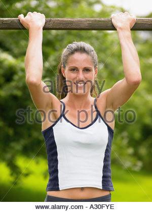 Young woman doing push ups - Stock Photo