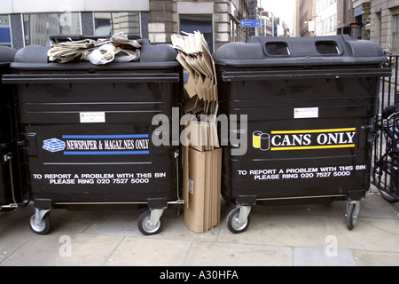 Two recycling bins for newspaper magazines and aluminium cans London UK - Stock Photo