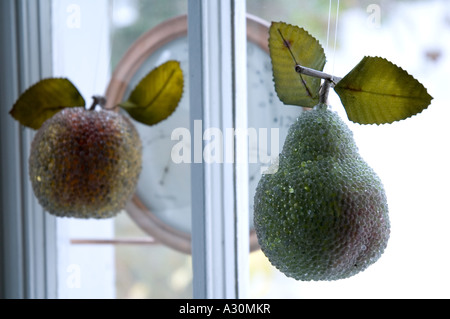 Crystal fruit Christmas decoration hanging in the window - Stock Photo