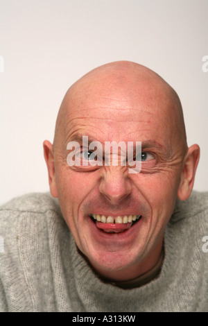 Character Actor pulling stupid face to camera - Stock Photo