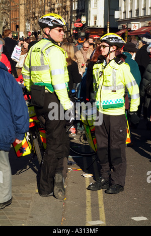 St John Ambulance uniformed members of a cycle responder unit on duty in central London England United Kingdom - Stock Photo