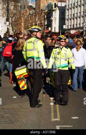 St John Ambulance uniformed members of cycle responder unit on duty in central London England United Kingdom - Stock Photo