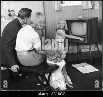 family watching tv 1950s. family watching tv 1950s - stock photo