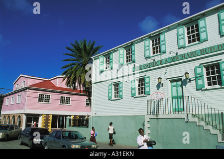 Colourful wooden buildings line Market Street in downtown St John s the capital city of Antigua - Stock Photo