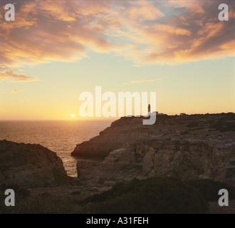 Alfanzina lighthouse at sunset, near Carvoeiro, the Algarve, Portugal - Stock Photo