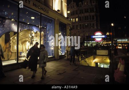 united kingdom christmas shopping at night in london outside harvey nichols store in knightsbridge - Stock Photo