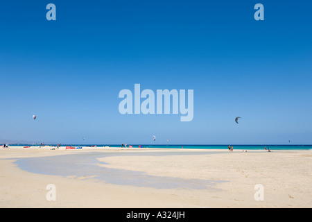 Kitesurfing on Playa Barca beach, Costa Calma, Fuerteventura, Canary Islands, Spain - Stock Photo