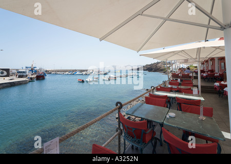 Seafront restaurant in the old town harbour, El Varadero, Puerto del Carmen, Lanzarote, Canary Islands, Spain - Stock Photo