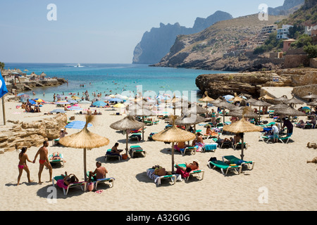 Holiday makers on the beach at Cala St Vincenc in Mallorca in the Mediterranean - Stock Photo