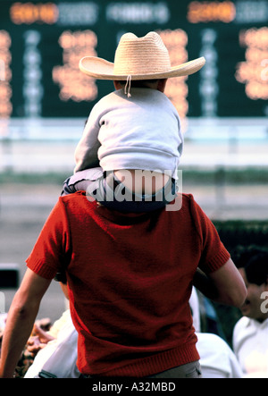 little boy on man's shoulders mexico - Stock Photo
