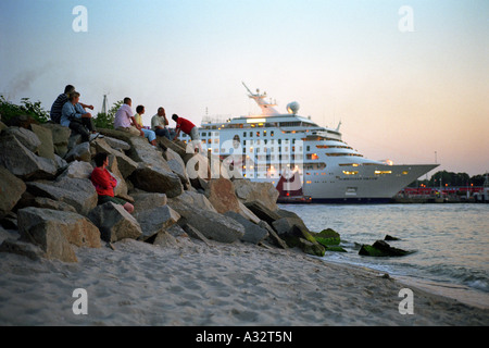 Tourists enjoy the evening, Warnemuende, Germany - Stock Photo