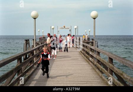 Tourist on a pier, Heiligendamm, Germany - Stock Photo