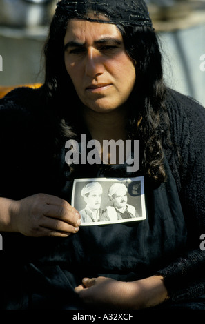 A tearful Barzani Widow from Qosh Tapa, holds a photograph of male relatives taken from their homes during the Anfa - Stock Photo