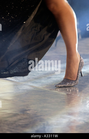 Leg of a young woman in high heels at the Miss Berlin 2006 contest, Germany - Stock Photo